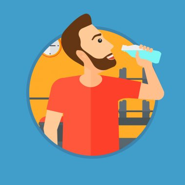 Sportive man drinking water.