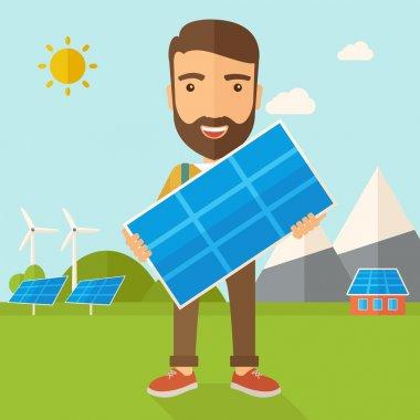 Man holding a solar panel.