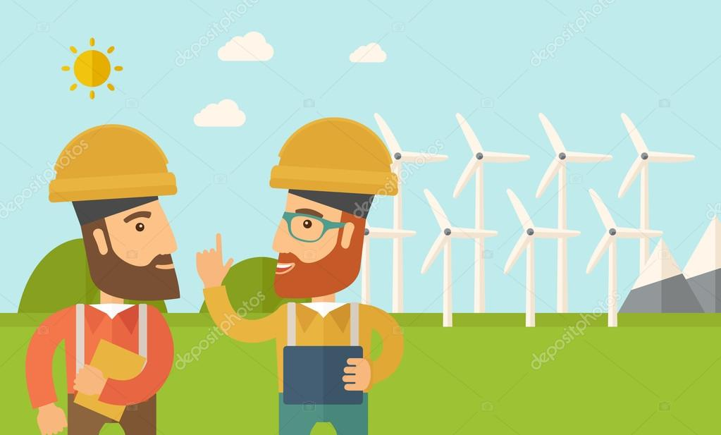 Two workers talking infront of windmills.