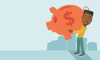 African businessman carries a big piggy bank for saving money.