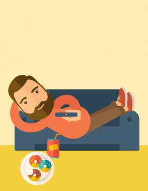 Man lying in the sofa holding a remote.