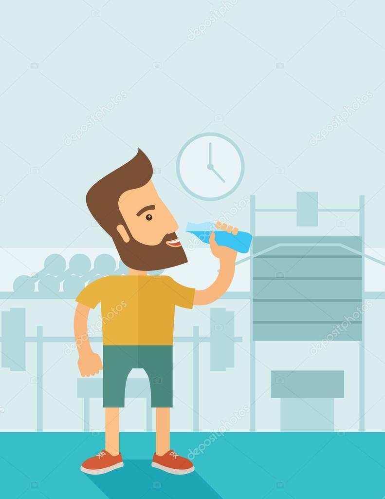 Gentleman drink a bottle of water while inside the gym.