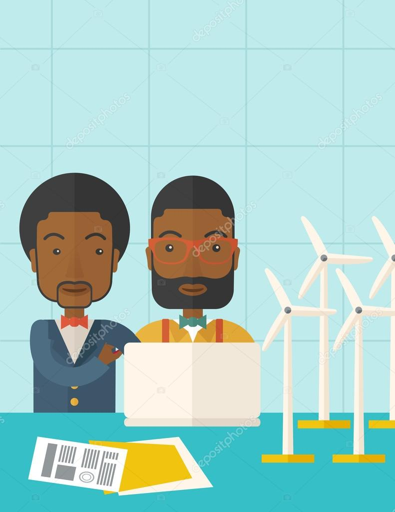 Two black Workers using laptop with windmills.