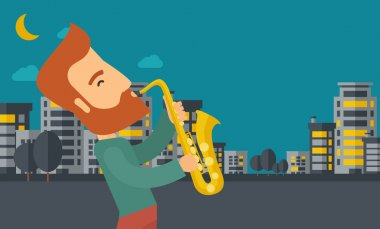 Saxophonist playing in the streets at night