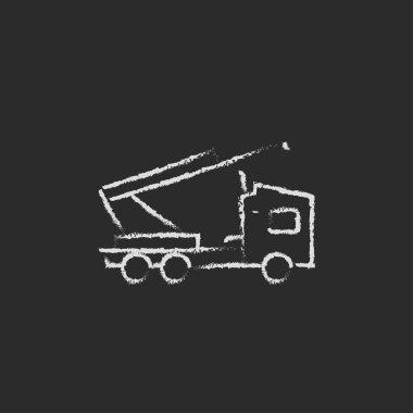 Machine with a crane icon drawn in chalk.