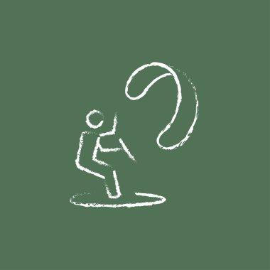 Kite surfing icon drawn in chalk.