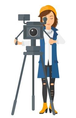 Camerawoman with movie camera.