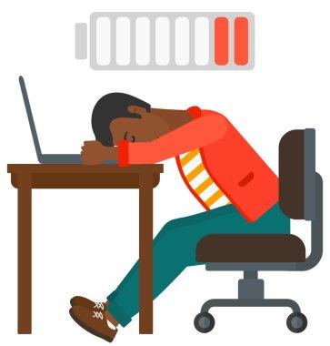 Man sleeping at workplace.
