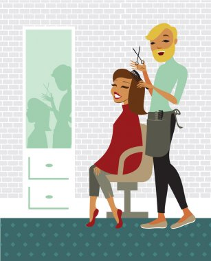 woman having her hair cut at the hairdresser salon