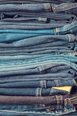 Stacked fashion blue jeans closeup