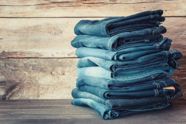 Stacked fashion blue jeans in store