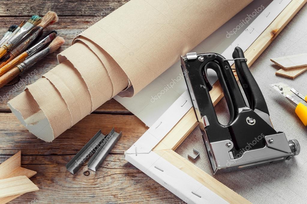 Artist canvas in roll, canvas stretcher, staple gun and paintbru