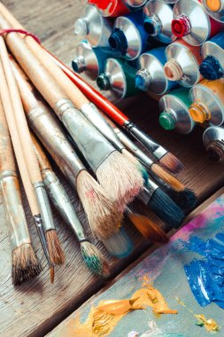 Vintage stylized photo of paintbrushes closeup, open multicolor