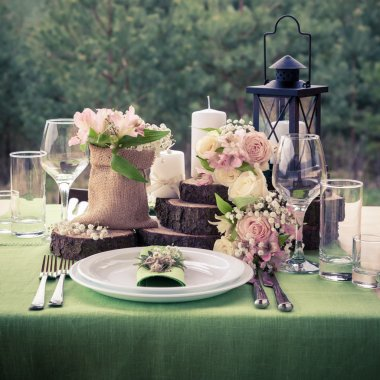 Wedding table setting decorated in rustic style.