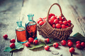 Fotografie Tincture bottles of hawthorn berries and ripe thorn apples