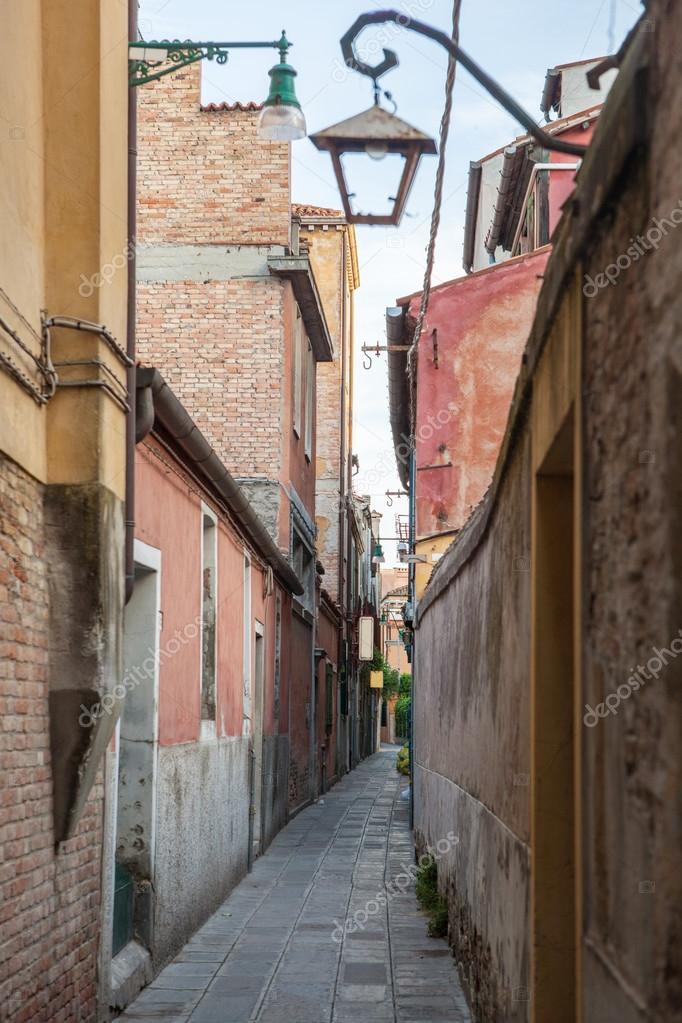 Фотообои Narrow street in the old town in Venice