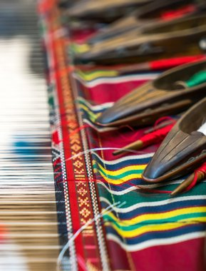Weaving shuttles and colorful textile