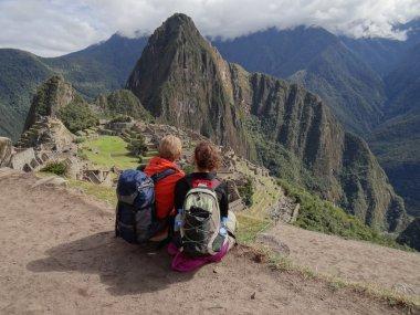 Couple admiring Machu Picchu