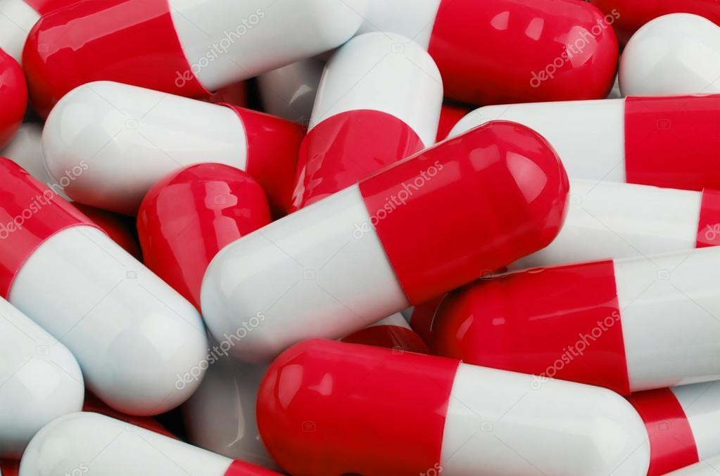 red and white pills stock photo krasyuk 106119964