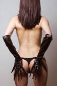 Fotografie attraktive Frau in Leder Latex Katze Kostüm
