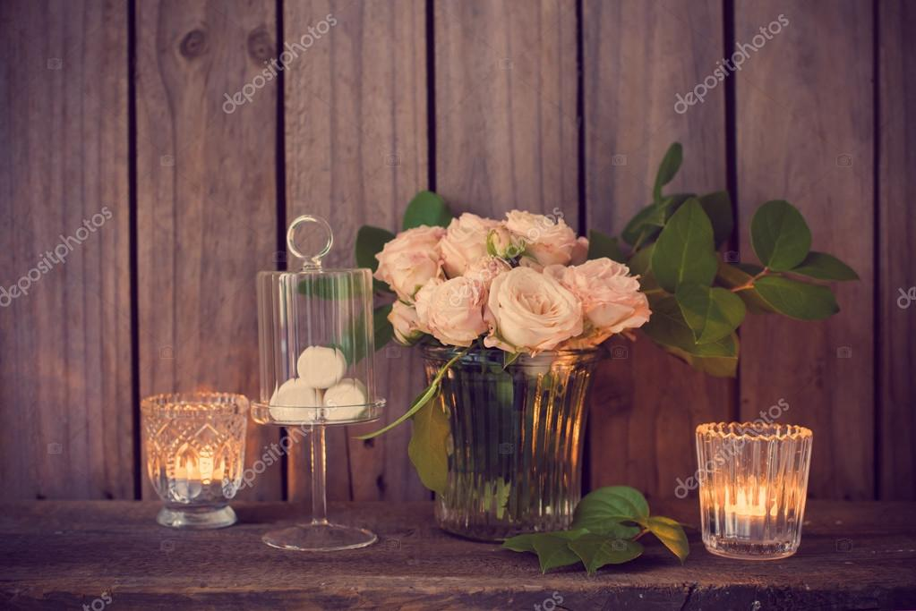 Elegant vintage wedding table decoration with roses and candles ...