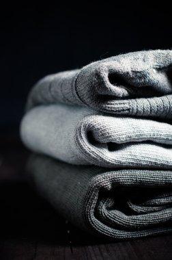 gray sweaters