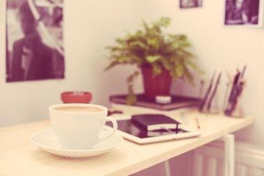 Cup of coffe in modern loft-style office