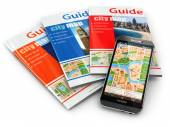 Fotografie GPS mobile phone navigation  and travel guide books.