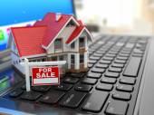 Realitní kancelář on-line. dům na klávesnici pro laptop.