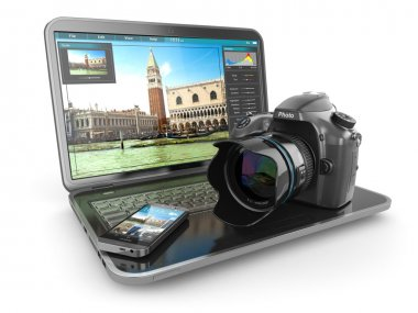 Photo camera, laptop and mobile phone. Journalist  or  traveler