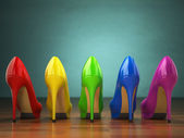Fotografie Choice of high heels shoes in different colors. Shopping concept