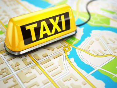 Taxi car sign on the city map.