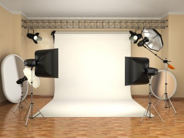 Photo studio with lighting equipment. Flashes, softboxes and ref