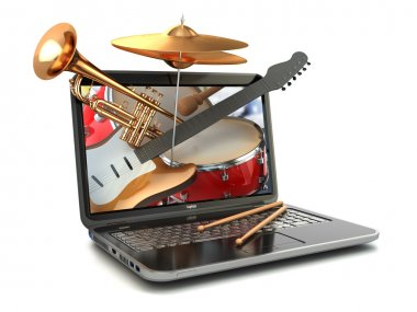 Digital music composer concept. Laptop and musical instruments.