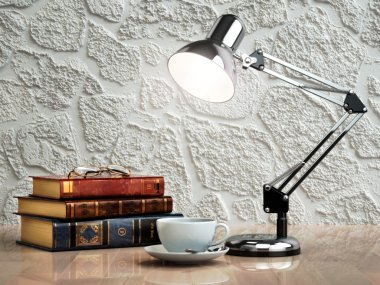 Vintage books coffee cup and desk lamp on the table. Place of work.  3d stock vector