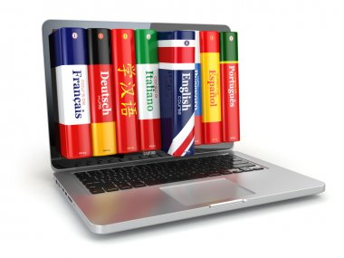 E-learning. Learning languages online. Dictionaries and laptop.
