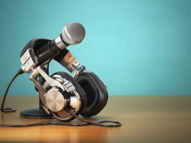 Microphone and headphones. Audio recording or radio commentator