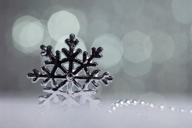 Silver snowflake on shiny background stock vector