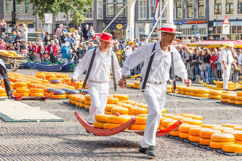 ALKMAAR, THE NETHERLANDS - SEPTEMBER 7: Carriers walking with ma