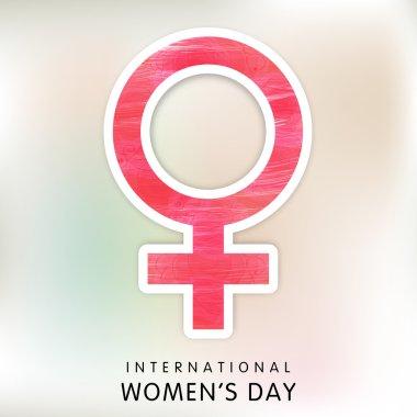Pink sticky for International Women's Day celebration.