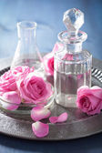 Fotografie aromatherapy set with rose flowers and flasks