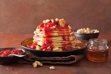 pancakes with strawberry jam and walnuts. tasty dessert