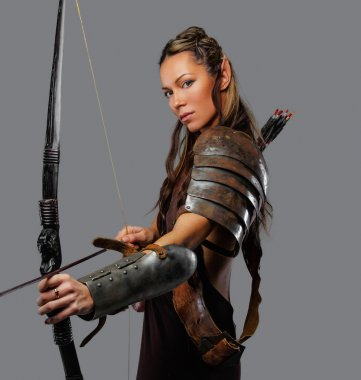warrior woman holds bow