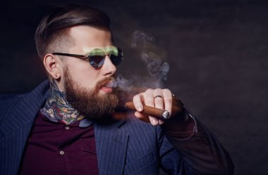 Bearded modern man in sunglasses.