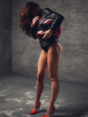 Sexy brunette woman in moto jacket