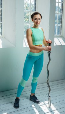 Slim fitness female in azure sportswear
