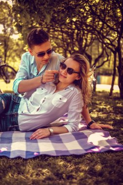 Sweat couple relaxing in summer park.