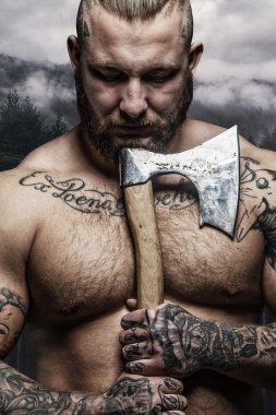 shirtless male with axe
