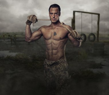 Shirtless muscular soldier