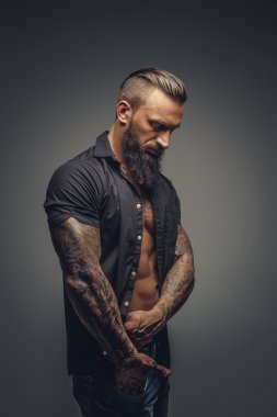 Tattooed male in black shirt